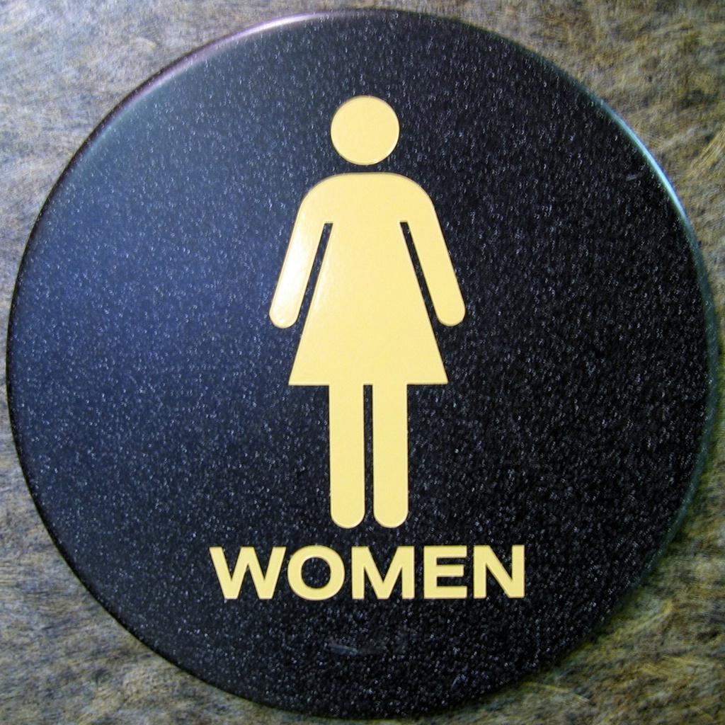 space menwomen men stock in bathroom hanging a public women photos image photo restroom s sign